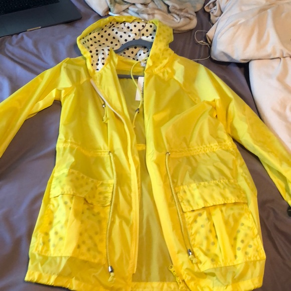 58d2f4d03a86a Yellow polka dot lined raincoat NWT